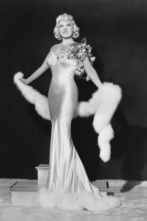 Actress Mae West wearing a satin dress in 1937.